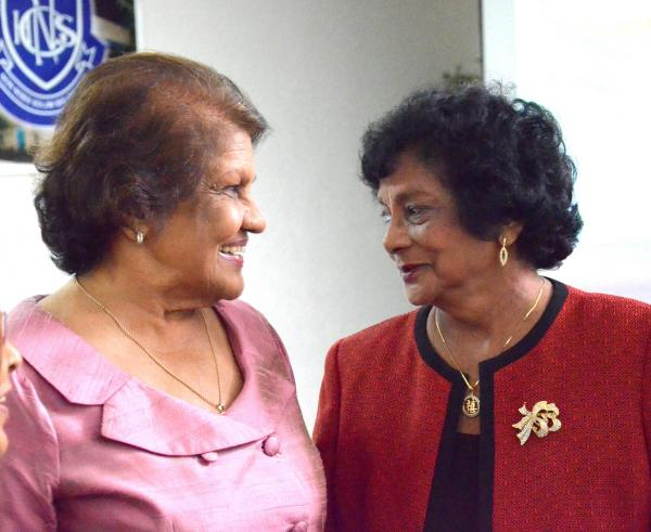Caption: First Lady Mrs. Jean Ramjohn-Richards chatting with Dr. Anna Mahase.