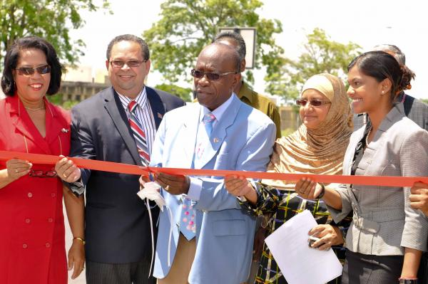 Minister Jack Warner cuts the ribbon to officially open the third of the Uriah Butler Highway, Mount Hope. Others in photos are from left Cheryl Blackman, Permanent Secretary, Ministry of Works and Infrastructure; Herbert Volney, Member of Parliament for St Joseph, Nafeesa Mohammed, Chairman, San Juan Laventille Regional Corporation and Stacy Roopnarine, Minister in the Ministry of Works and Infrastructure