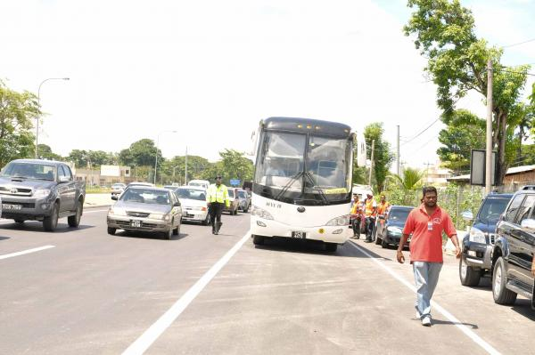 A  PTSC bus en route from Chaguanas, was the first to use the new lane of the highway