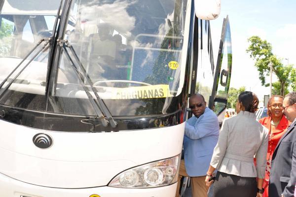 Minister Jack Warner entering the PTSC bus to greet passengers