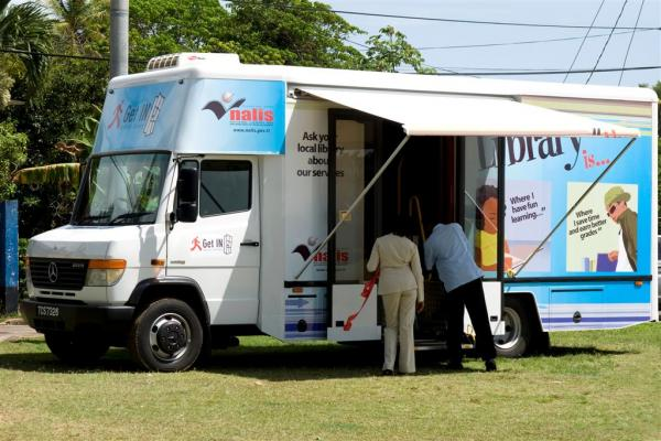 Caption: The mobile library on location at the Blanchisseuse Recreation Ground.