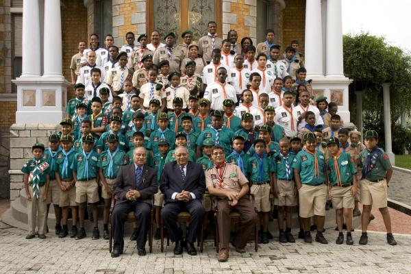 Members of the Scout Association of Trinidad and Tobago with President of the Association Justice Anthony Lucky (front left); His Excellency President George Maxwell Richards (centre) and National Scout Commissioner Azamuddin Khan.