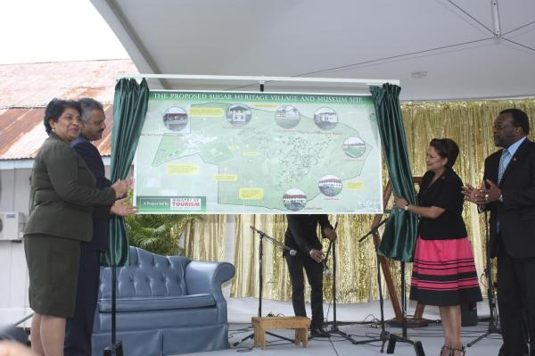 Caption: The Prime Minister with the assistance of other ministers unveil the project site map.