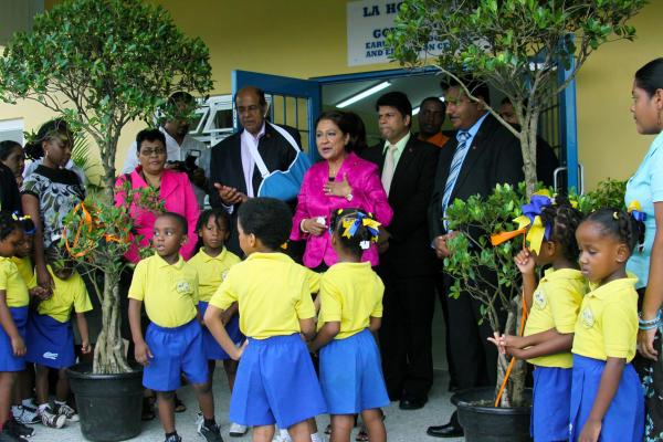 Caption: Prime Minister Kamla Persad-Bissessar, addressing the gathering at the opening of the La Horquetta ECCE Centre.