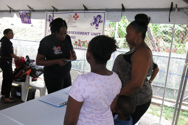 Staff of the NWRHA, Child Assessment Unit provides free health care to this family during the Proactive Communities Outreach