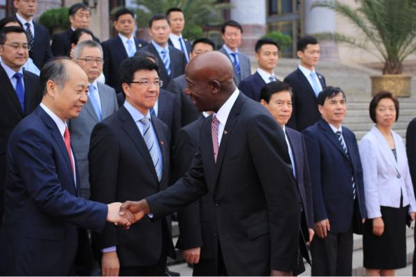 Prime Minister Rowley greets officials of the People's Republic of China