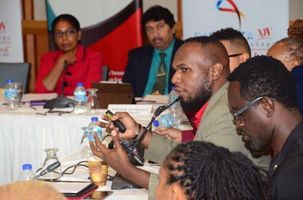 Second from right: Marlon de Bique, Cultural Officer II of the MCDCA and member of the Host Country Management Committee, addresses attendees during the IFD meeting at the Hilton Trinidad and Conference Centre